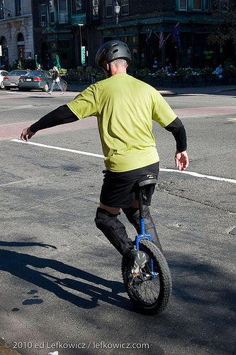 Unicyclist practicing on Washington Street, Hoboken, New Jersey.