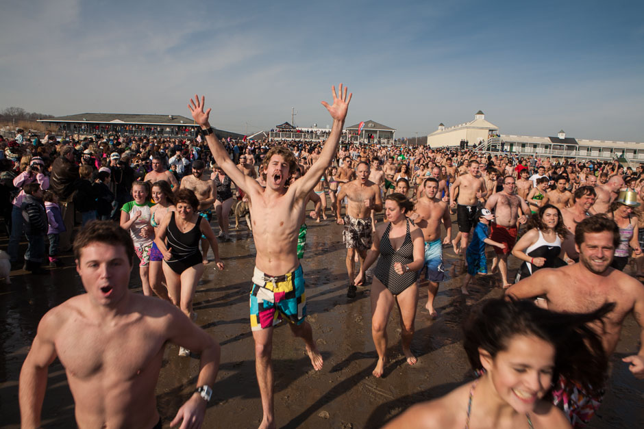 Swimmers running toward the water at the annual Polar Bear Swim on New Year's Day, Narragansett, Rhode Island.
