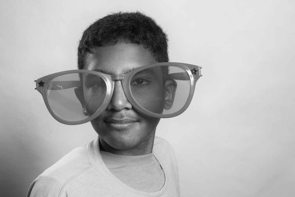 A boy with oversized glasses for Flashes of Hope