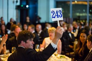 A successful bidder at a benefit auction for the New York Pops.