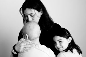 A mother and her children, one of whom is a cancer patient, photographed for Flashes of Hope.