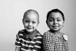 Two young cancer patients, photographed for Flashes of Hope