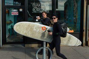 Surfers outside Rockaway Beach Bakery. Shot for Edible Queens magazine.