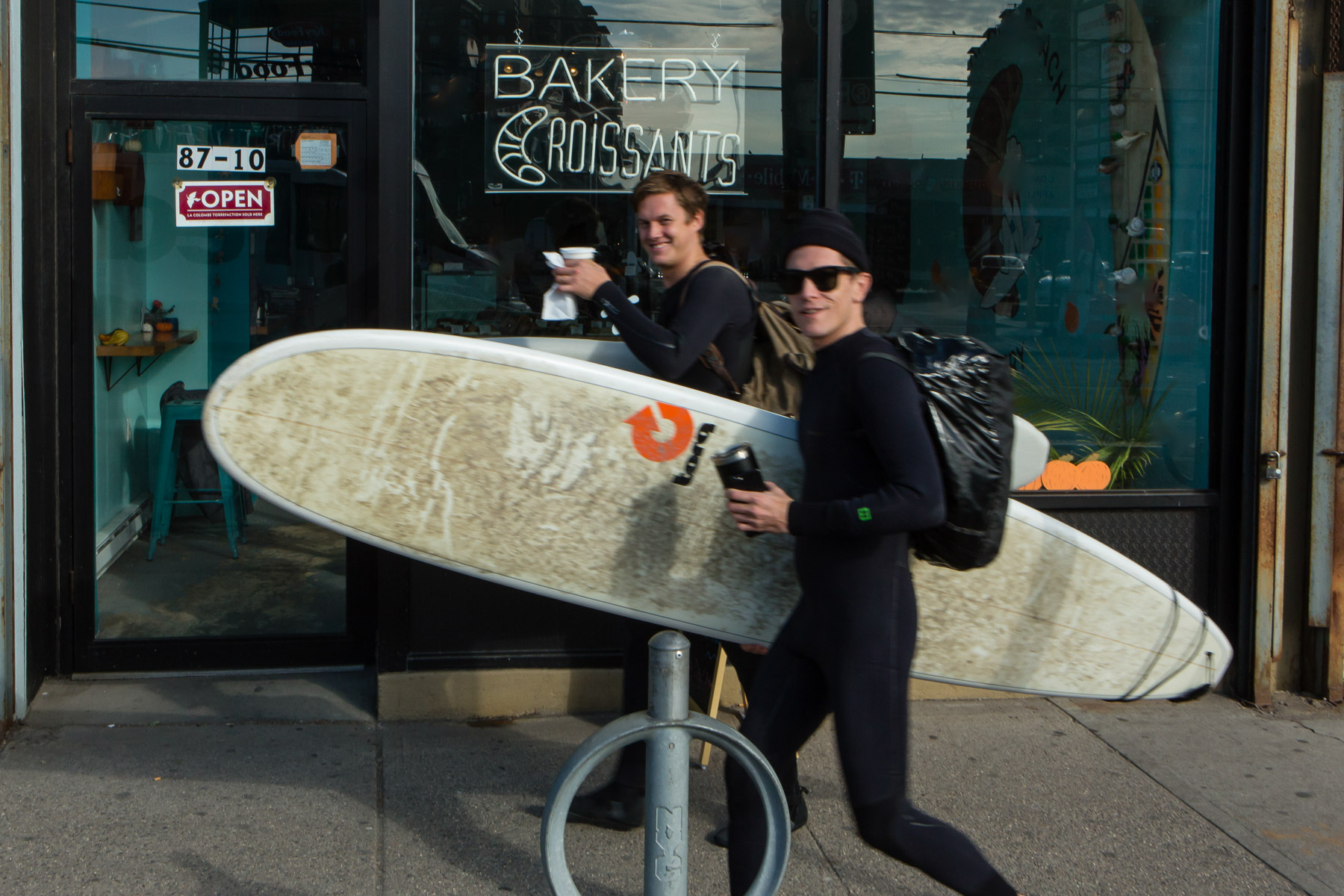 Surfers outside Rockaway Beach Bakery. Shot for Edible Queens magazine.