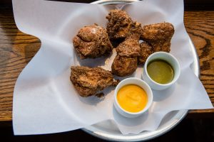 Fried chicken with honey carrot and jalapeno herb dipping sauces at The Pomeroy, shot for Edible Queens magazine.