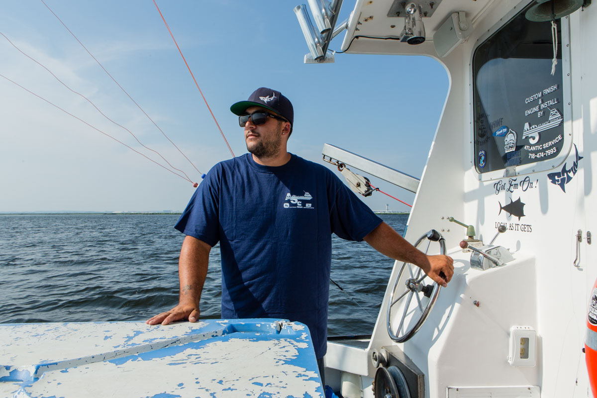 "Pat Butera at the helm of his charter fishing boat ""Forever Two Worlds"" in Jamaica Bay. Shot for Edible Queens magazine."