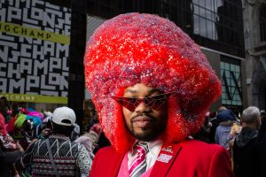 An oversized bright red Afro at the Easter Bonnet Parade and Festival on New York's Fifth Avenue.