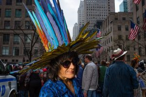 An ornate hat apparently made entirely of colorful feathers at the Easter Bonnet Parade and Festival on New York's Fifth Avenue.
