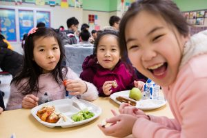 Students at lunch at Flushing's PS 244, the first school in the city to be all vegetarian. Photographed for Edible Queens magazine.