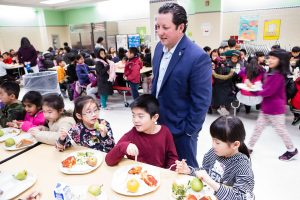 Robert Groff, principal at Flushing's PS 244, engages with the pupils in the school's in the lunchroom. Photographed for Edible Queens magazine.